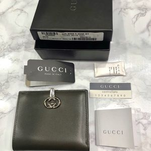 Gucci compact dark green wallet